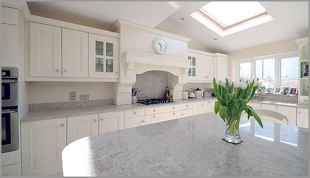 spacious room glows with the white granite countertops